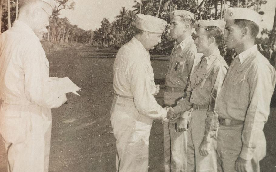 Second Lt. Sam Folsom, middle right, receives an award in this undated photo from World War II.