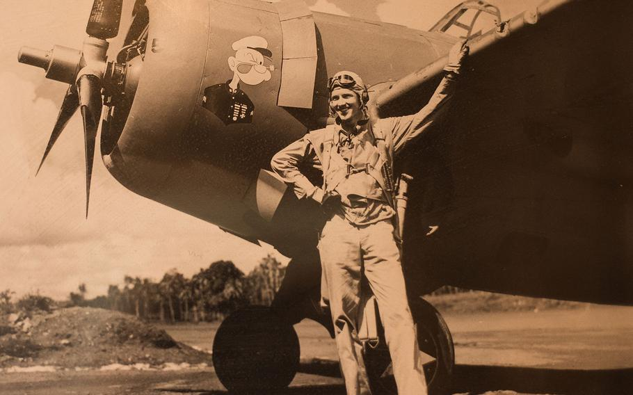 Sam Folsom poses in Samoa with his F4F Wildcat with Popeye art in 1942, after he left the Battle of Guadalcanal in World War II. He was credited with shooting down three Japanese aircraft -- two G4M Betty Bombers and a D3A Val dive bomber-- at Guadalcanal.