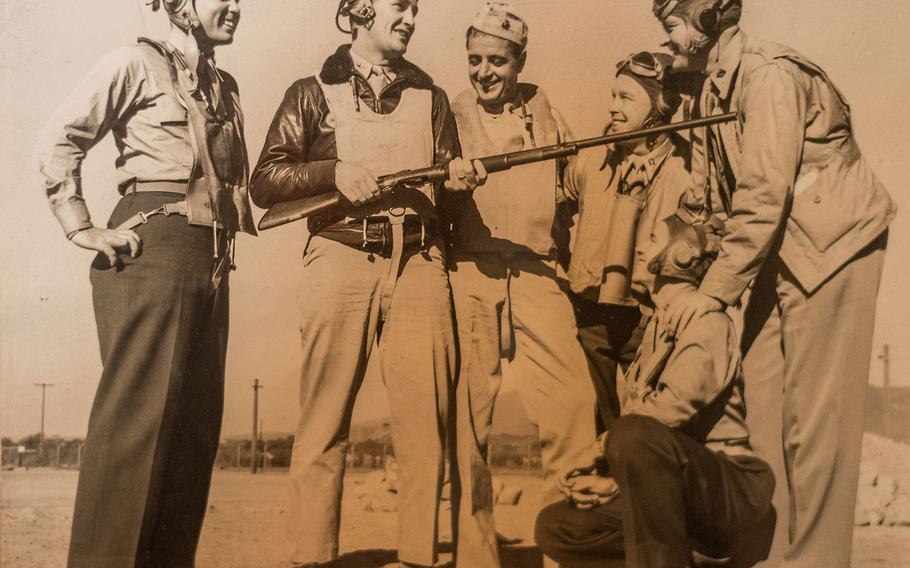 Sam Folsom, kneeling right, is photographed in 1944 with other servicemembers who had served in his Marine fighter squadron, VMF 121, at Guadalcanal in World War II two years earlier. The unit's executive officer Joe Foss, second from left holding the rifle, was a renowned fighter pilot who earned ace status, shooting down 26 Japanese aircraft at Guadalcanal, and earned the Medal of Honor for his actions in that battle. He went on to become a brigadier general in the South Dakota National Guard and served as that state's governor.