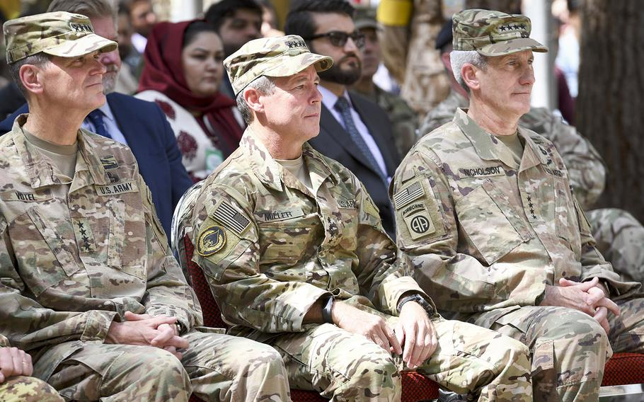 Gen. Austin Scott Miller is flanked by U.S. Central Command Gen. Joseph Votel and outgoing Gen. John Nicholson as Miller assumed command of NATO forces in Afghanistan in a ceremony Sunday at Resolute Support Headquarters in Kabul.