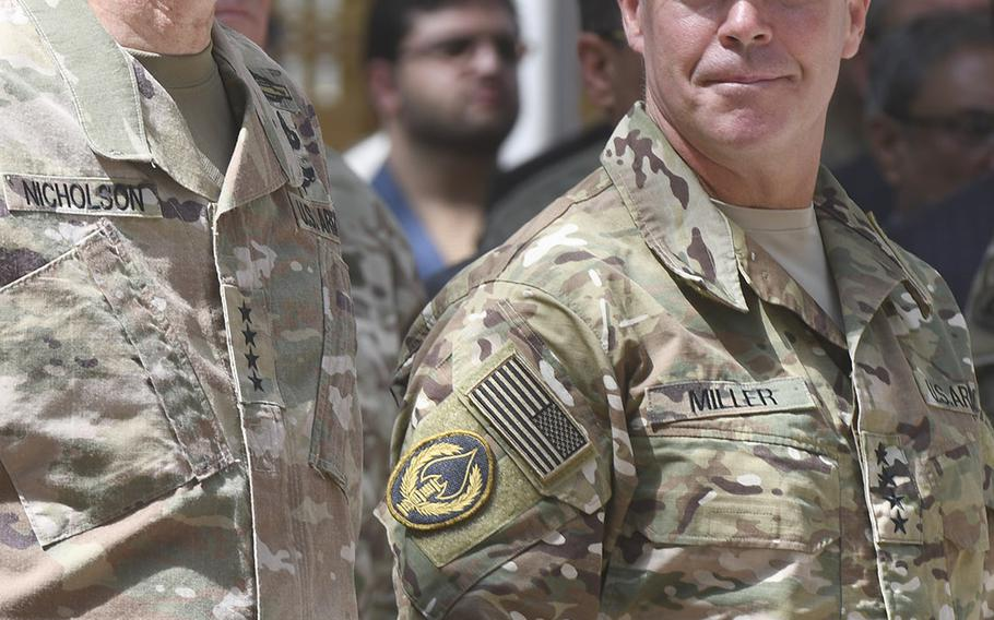 Gen. Austin Scott Millr, right,  assumed command of NATO forces in Afghanistan from Gen. John Nicholson  in a ceremony Sunday at Resolute Support Headquarters in Kabul.