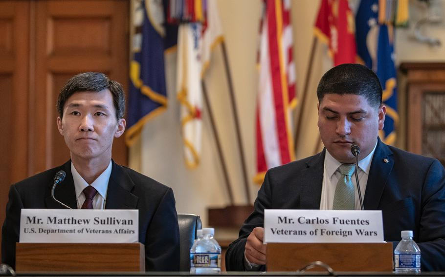 Matthew Sullivan, a deputy undersecretary with the VA's National Cemetery Administration and Carlos Fuentes, director of the Veterans of Foreign Wars, prepare to testify before the House Committee on Veterans' Affairs on Wednesday, Sept. 5, 2018, on Capitol Hill in Washington.