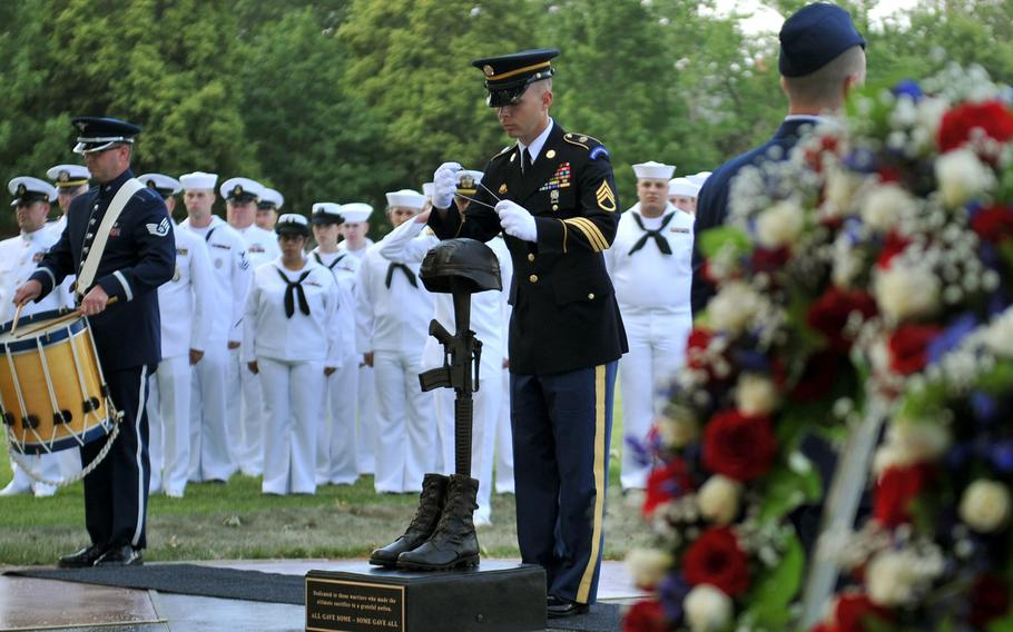 A dog tag chain is placed around the statue on the Fallen Warrior Memorial May 24, 2012, at Offutt Air Force Base, Nebraska.