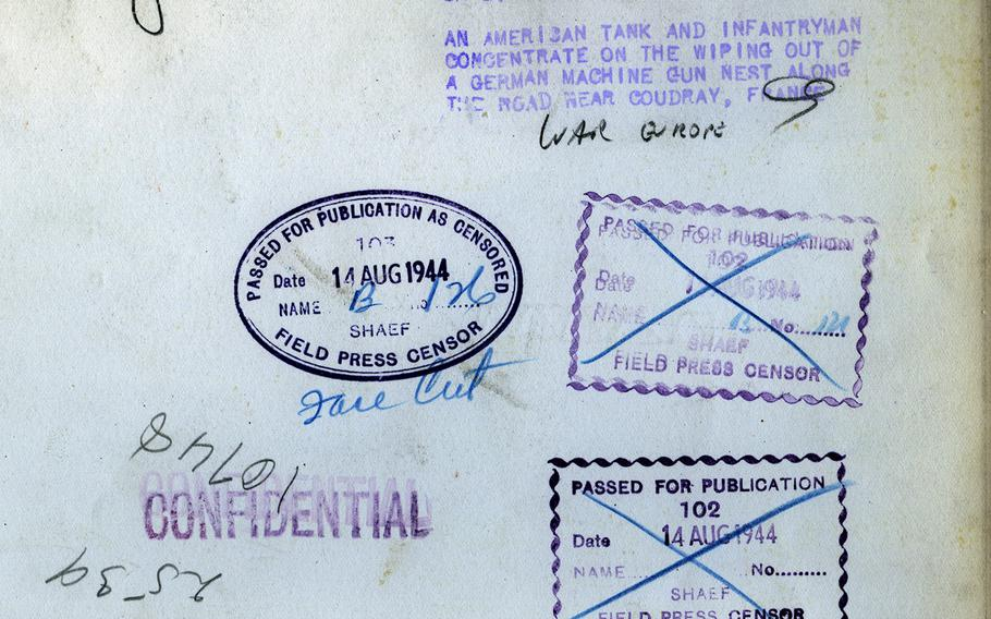 Various censors' stamps on the back of the tank photo.