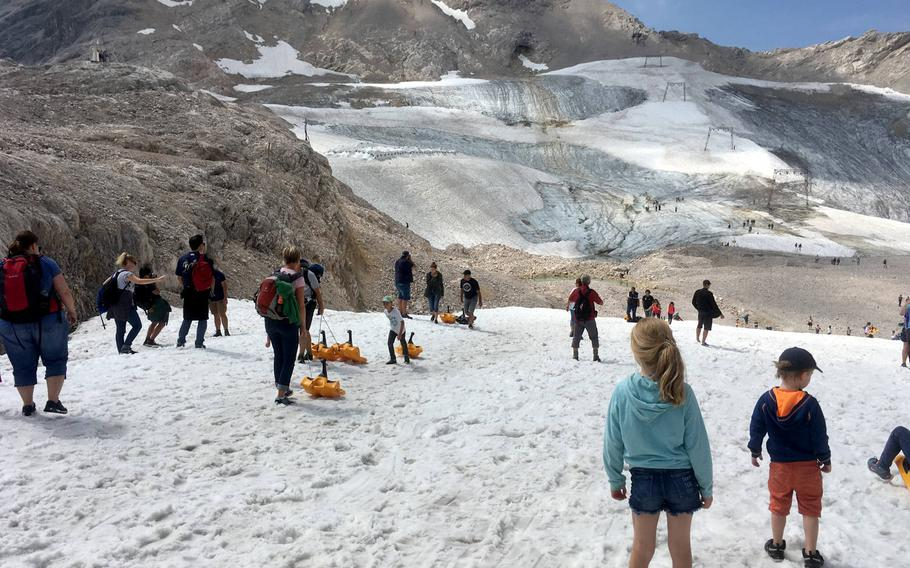 On the Zugspitze glaciers provide a little bit of snow, which means sledding and snowball fights even in the summer.
