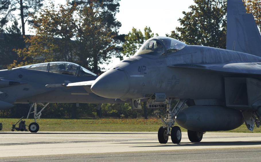 A U.S. Navy F-18 Super Hornet taxis before take-off during a training hosted by the 48th Fighter Wing at RAF Lakenheath, England, Tuesday, Oct. 9, 2018.