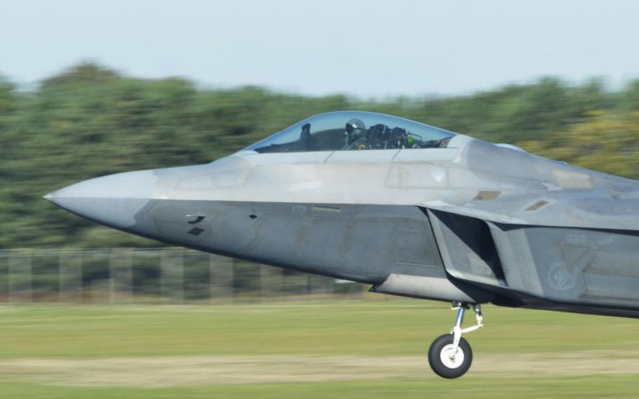 An F-22 Raptor takes off from RAF Lakenheath, England, Tuesday, Oct. 9, 2018, during training hosted by the 48th Fighter Wing. The aerial wargames include two squadrons of local F-15s, eight visiting F-18s and six F-22 Raptors.