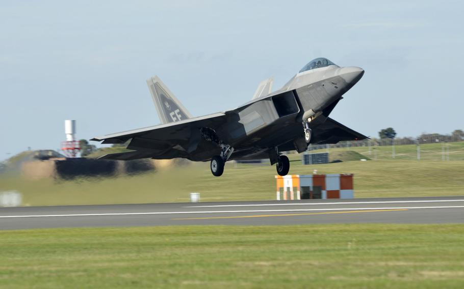 An F-22 Raptor takes off from RAF Lakenheath, England, Thursday, Oct. 11, 2018, during training hosted by the 48th Fighter Wing.