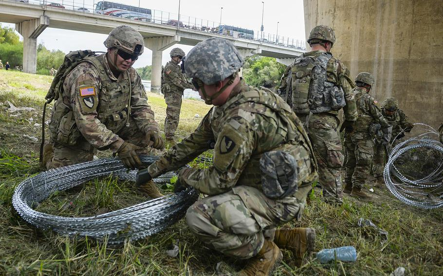 Soldiers from the 97th Military Police Brigade, and 41st Engineering Company, Fort Riley, Kansas, work with U.S. Customs and Border Protection at the Hidalgo, TX., port of entry, applying 300 meters of concertina wire along the Mexico border in support of Operation Faithful Patriot, November 2, 2018.