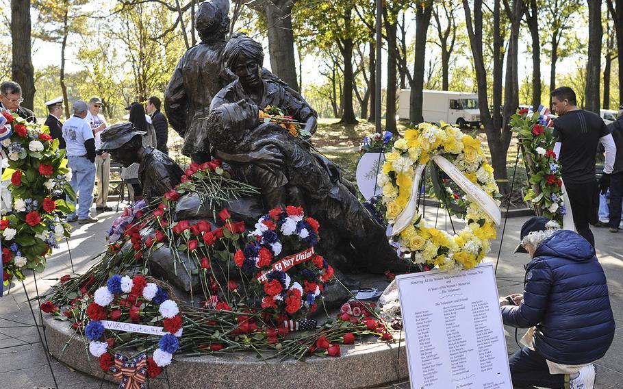 Visitors covered the Vietnam Women's Memorial in flowers for Veterans Day on Sunday, Nov. 11, 2018.