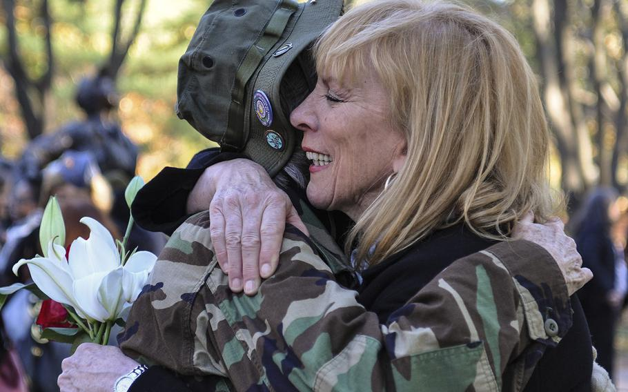 Jane McCarthy, left, hugs Janis Nark, right, at the Vietnam Women's Memorial on Sunday, Nov. 11, 2018. Both women were part of the Army Nurse Corps. Nark began to cry while recounting some of the patients she treated in Vietnam.