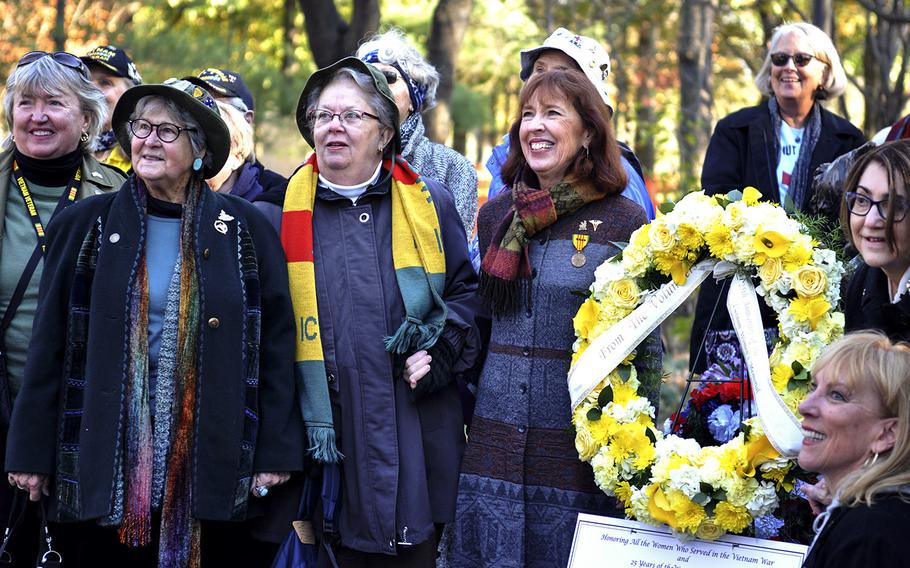 Diane Carlson Evans, left, and Amelia Jane Carson, left, pose for a photo in front of the Vietnam Women's Memorial on Nov. 11, 2018. The two women, both Army nurses in Vietnam, led the charge to establish the memorial. It was dedicated 25 years ago, on Nov. 11, 1993.