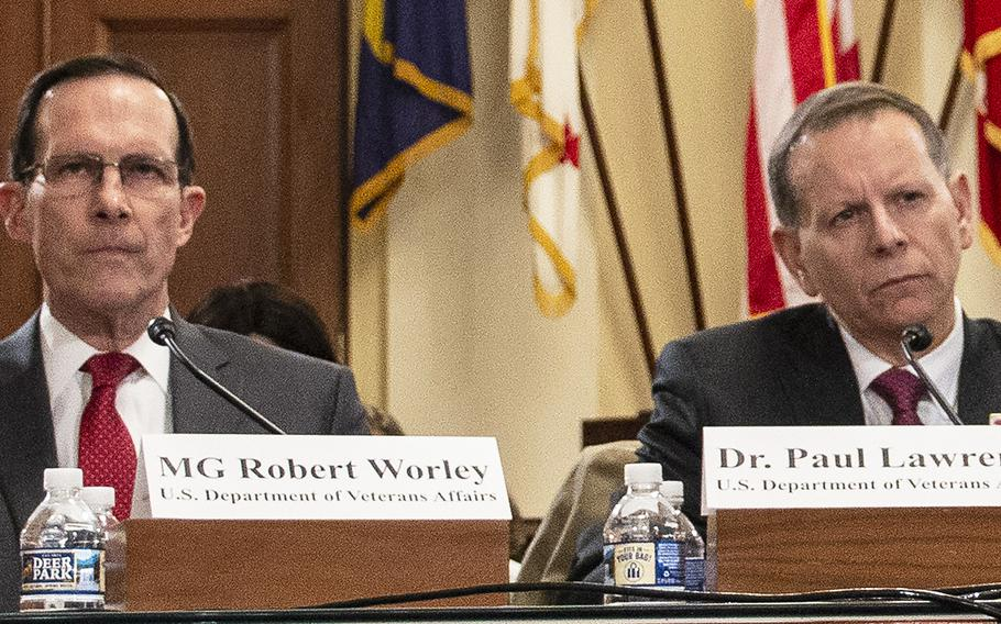 Retired Air Force Maj. Gen. Robert M. Worley II, director of education service for the Veterans Benefit Administration, and Paul R. Lawrence, the VBA's undersecretary for benefits, listen to opening statements during a House Veterans' Affairs subcommittee hearing on delays in GI Bill payments, Nov. 15, 2018 on Capitol Hill.