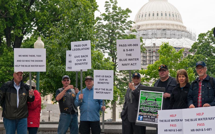In a May, 2016 file photo, Blue Water Navy Vietnam veterans gather near the U.S. Capitol to rally for support of passage of a bill to regain benefits related to Agent Orange exposure.