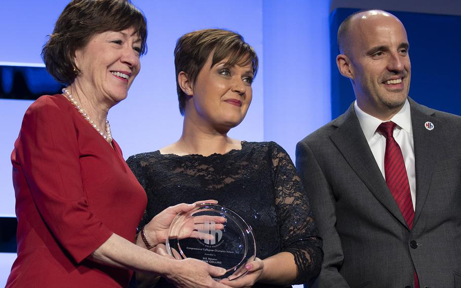 Sen. Susan Collins, R-Maine, left, is presented with the Congressional Caregiver Champion Award by caregiver Marjorie Pennington and Elizabeth Dole Foundation's executive director, Steve Schwab, during the foundation's Heroes and History Makers event in Washington, D.C., Nov. 29, 2018.