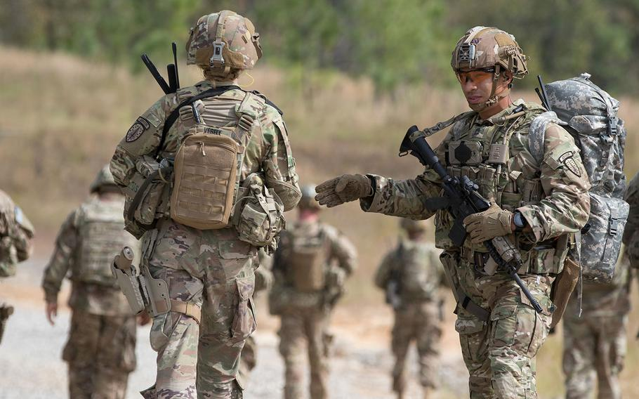 Soldiers from the 2nd Battalion, 2nd Security Force Assistance Brigade move to a nearby village as part of a live-fire exercise at Fort Bragg, N.C., on Oct. 24, 2018.