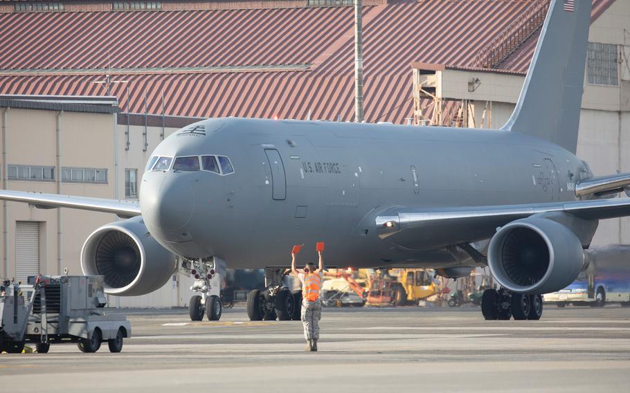 An airman with the 374th Maintenance Squadron marshals a Boeing KC-46A Pegasus at Yokota Air Base, Japan, Oct. 23, 2018.