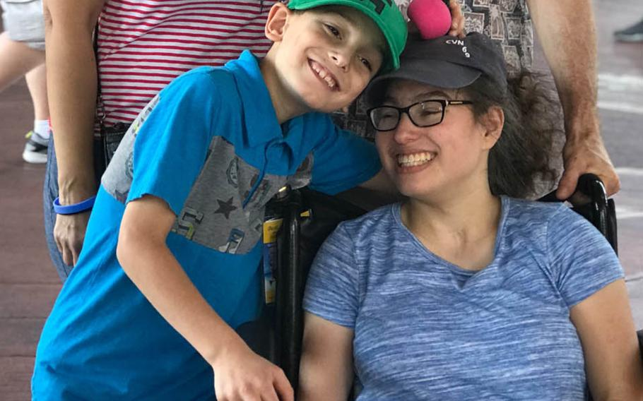 Chase, 9, and Marisa, 15, the children of Michelle Norman and husband Navy Capt. Cassidy Norman, pose during a  trip to Disney World in December 2018. The  Normans are fighting the Virginia Beach school district to keep Marisa, who is severely disabled, in a private school.