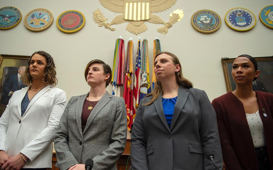 From left, Army Capt. Alivia Stehlik, Army Capt. Jennifer Peace, Army Staff Sgt. Patricia King, and Navy Petty Officer 3rd Class Akira Wyatt prepare to testify about military transgender service policy during a hearing on Capitol Hill in Washington on Wednesday, Feb. 27, 2019.