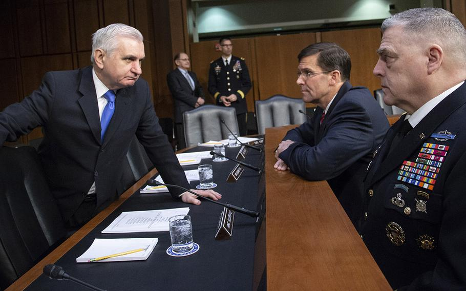 Senate Armed Services Committee Ranking Member Jack Reed, D-R.I., talks with Army Secretary Mark T. Esper and Army Chief of Staff Gen. Mark A. Milley before a hearing on military housing problems, March 7, 2019, on Capitol Hill.