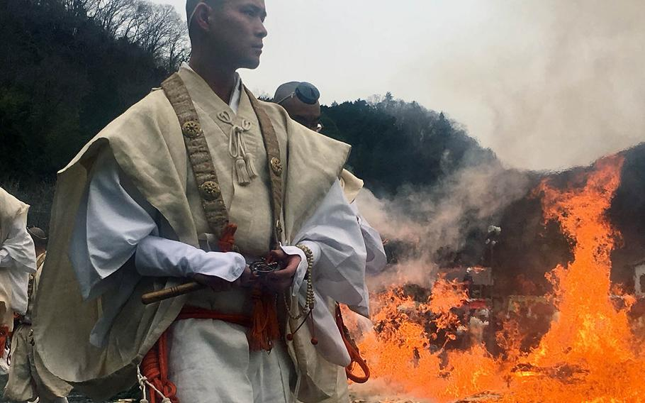 Buddhist monks set the stage for an annual fire-walking ritual at Mount Takao, Japan, Sunday, March 10, 2019.