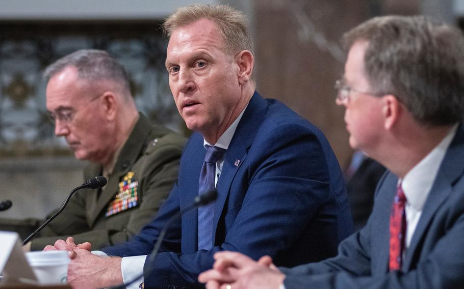"""Acting Secretary of Defense Patrick Shanahan testifies during a Senate Armed Services Committee hearing on Capitol Hill in Washington on Thursday, March 14, 2019. Also testifying are, at left, Chairman of the Joint Chiefs of Staff Gen. Joseph Dunford, and, at right, Under Secretary of Defense David Norquist. In response to questioning by Sen. Elizabeth Warren, Shanahan said  """"there is no slush fund."""""""