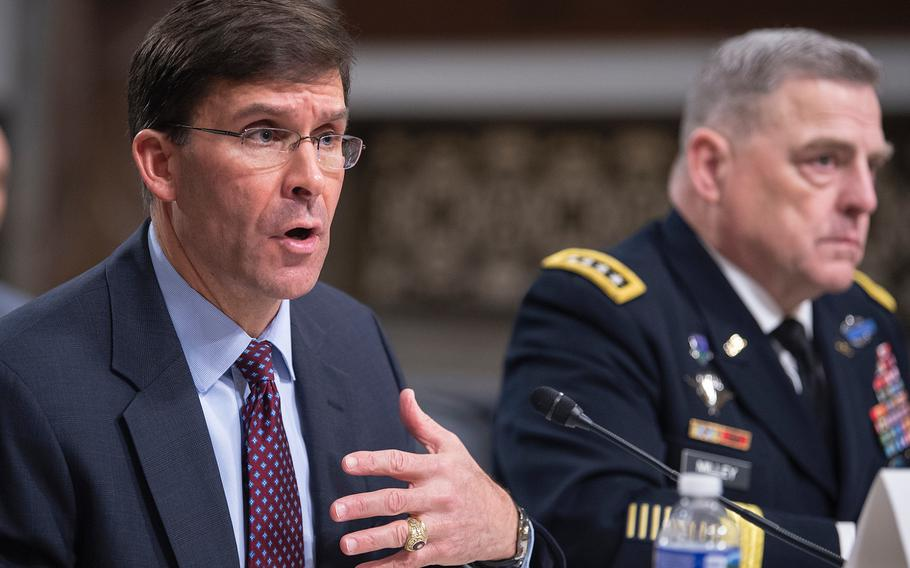 Army Secretary Mark Esper testifies before the Senate Armed Services Committee on Tuesday, March 26, 2019, during a hearing on Capitol Hill in Washington. Also testifying at right is Army Chief of Staff Gen. Mark Milley .