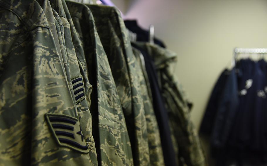 Airmen Battle Uniforms hang on a rack Feb. 8, 2018, at Altus Air Force Base, Okla.