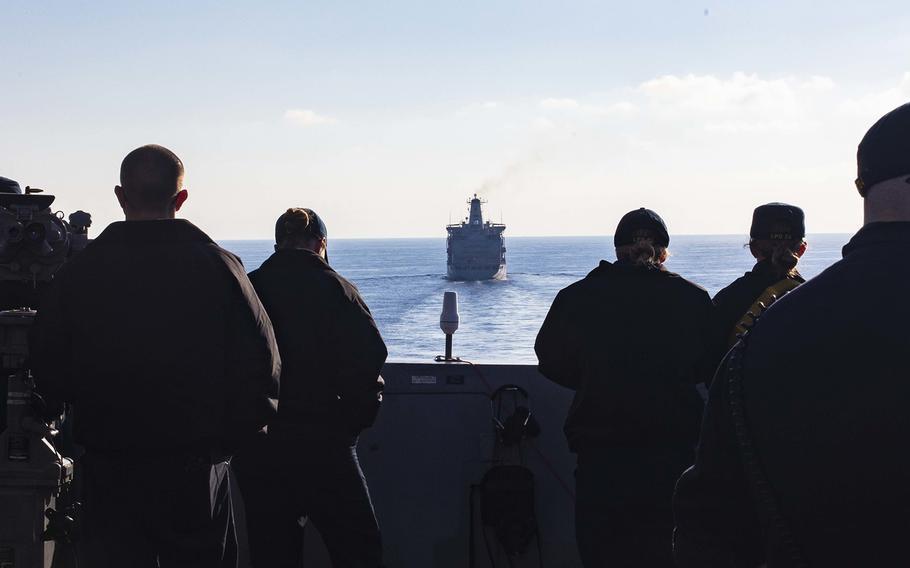 The San Antonio-class amphibious transport dock ship USS Arlington (LPD 24) approaches the Henry Kaiser-class fleet replenishment oiler USNS John Lenthall (T-AO 188) during a replenishment-at-sea, April 3, 2019.