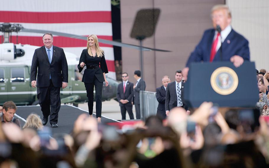 President Donald Trump invited Secretary of State Mike Pompeo and presidential advsier Ivanka Trump to the stage during his speech to servicemembers and families on Osan Air Base, South Korea, Sunday, June 30, 2019.
