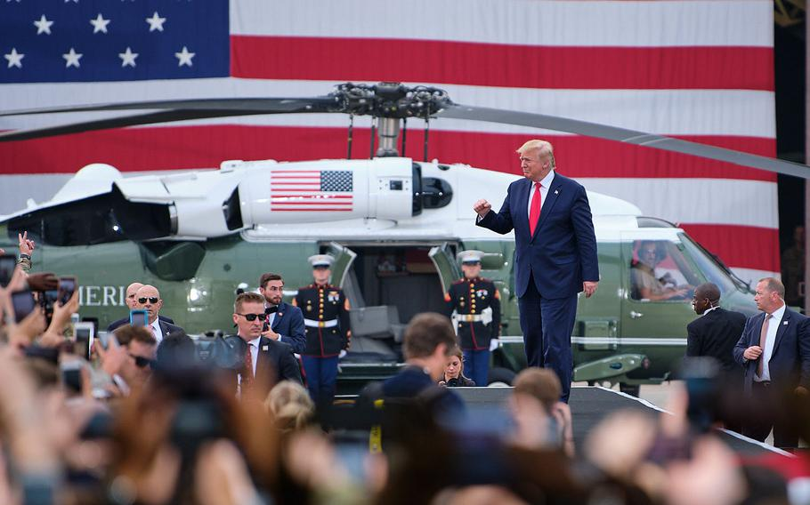 President Donald Trump takes the stage to speak to servicemembers at Osan Air Base, South Korea, Sunday, June 30, 2019.