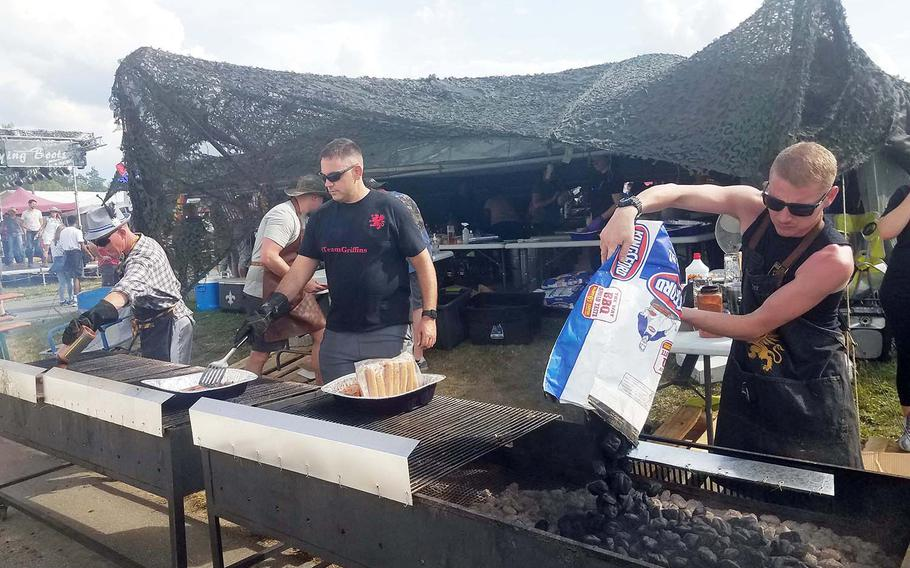 U.S. soldiers work one of the grills at the German American Volksfest in Grafenwoehr, Germany, Friday, Aug. 2, 2019.