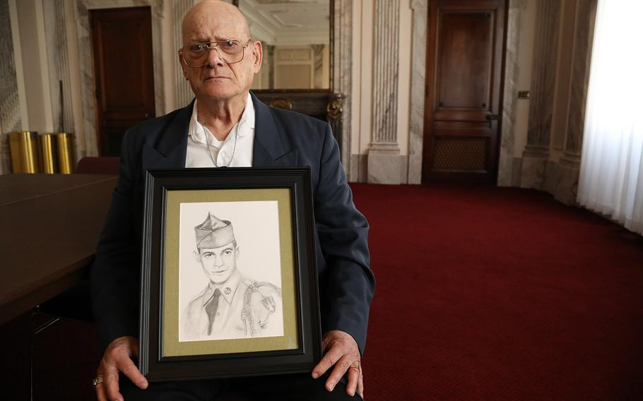 Clifton Sargent, holds a portrait of his brother Spc. 4 Donald Sargent, in a room at the Russell Senate Building March 15, 2019.