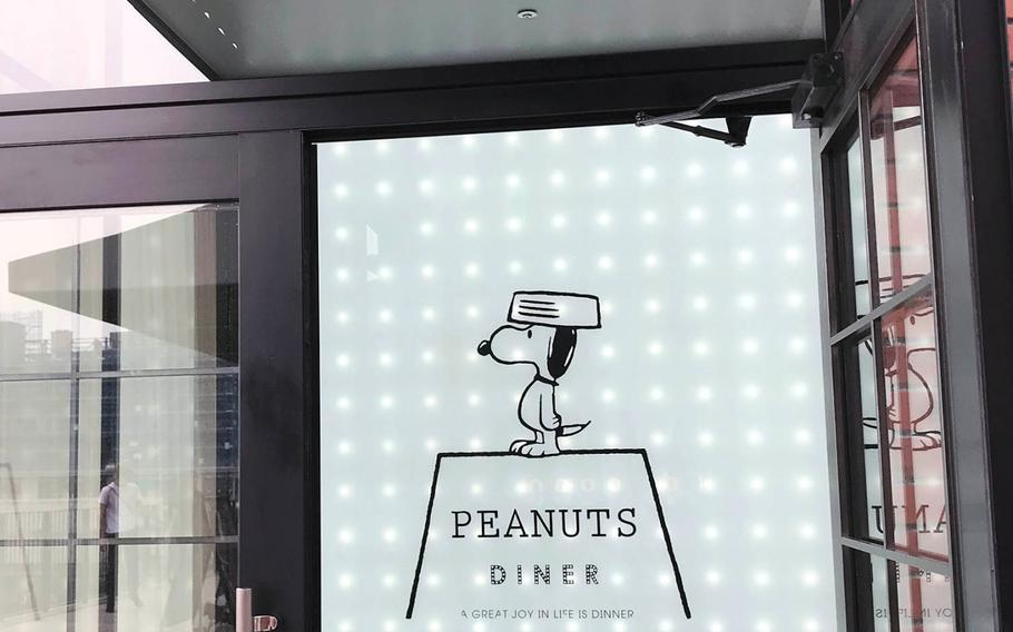 """A drawing of Snoopy welcomes customers to the Peanuts Diner, a restaurant inspired by the comic strip """"Peanuts,' in Yokohama, Japan."""