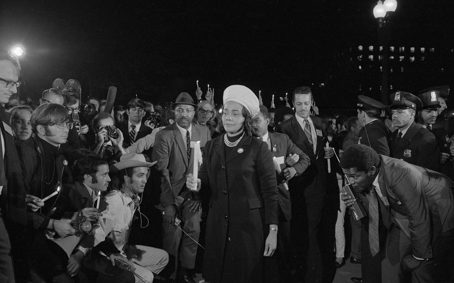 Coretta Scott King holding a candle and leading a march at night to the White House as part of the Moratorium to End the War in Vietnam which took place on October 15, 1969.