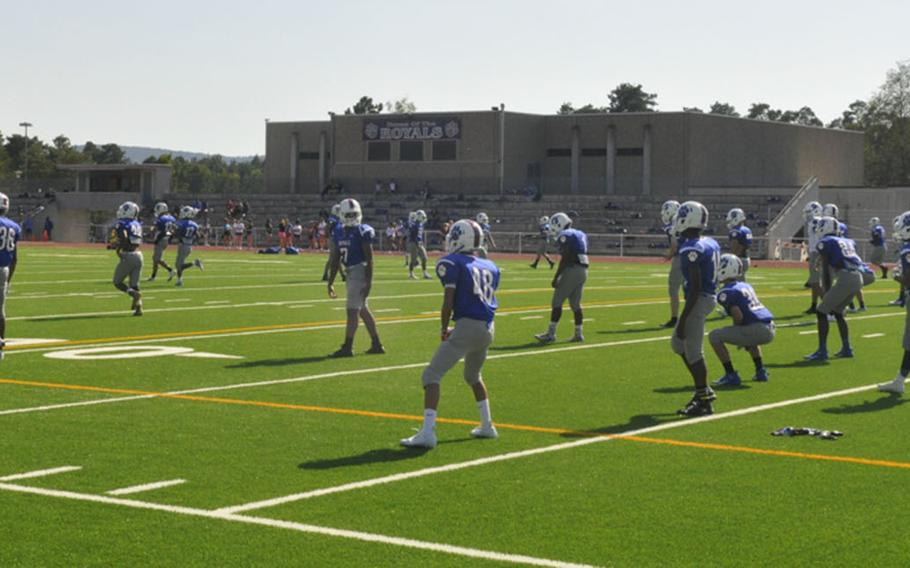 Ramstein Royals players warm up for a preseason practice Friday, Aug. 23, 2019, at Ramstein Air Base. The team reported 60-plus players for the fall camp, down from its previous heights but still on the high end for Division I squads.
