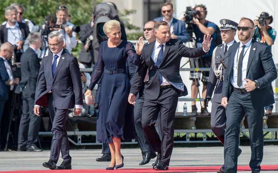 Polish President Andrzej Duda and wife Agata arrive at a ceremony honoring the 80th anniversary of the start of World War II in Warsaw, Poland, Sunday, Sept. 1, 2019
