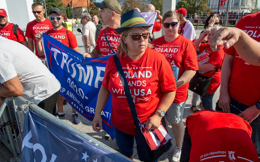 Polish citizens who support the United States and President Trump set up before a ceremony honoring the 80th anniversary of the start of World War II in Warsaw, Poland, Sunday,  Sept. 1, 2019