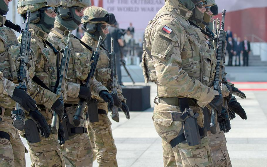 Polish soldiers march at a ceremony honoring the 80th anniversary of the start of World War II in Warsaw, Poland, Sunday, Sept. 1, 2019