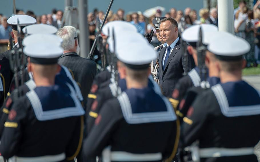 Poland President Andrzej Duda walks by military formations during a ceremony honoring the 80th anniversary of the start of World War II in Warsaw, Poland, Sunday, Sept. 1, 2019