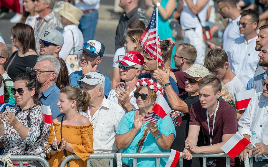 Spectators applaud during a ceremony honoring the 80th anniversary of the start of World War II in Warsaw, Poland, Sunday, Sept. 1, 2019