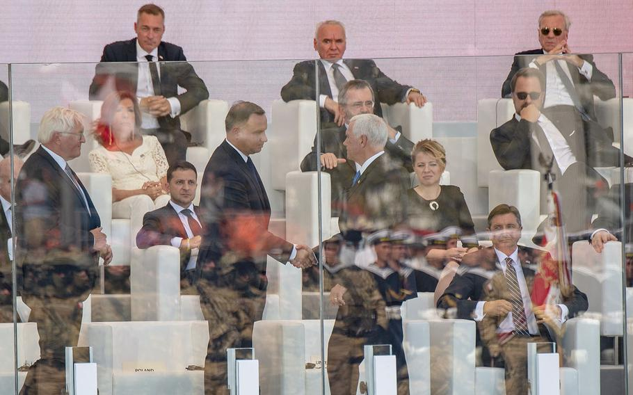 Vice President Mike Pence shakes hand with Poland President Andrzej Duda during a ceremony honoring the 80th anniversary of the start of World War II in Warsaw, Poland, Sept. 1, 2019
