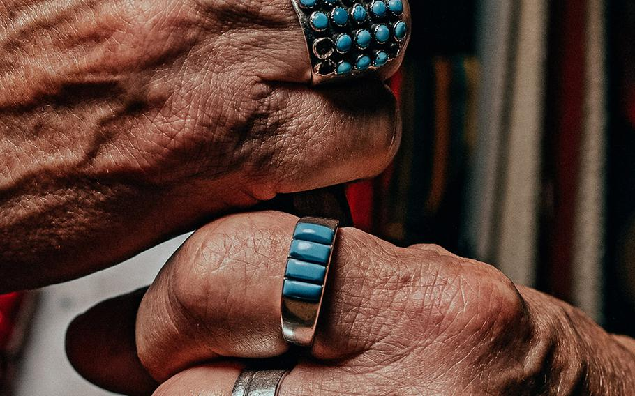 The hands of Harvey Pratt, designer of the National Native American Veterans Memorial. A jury selected Pratt's design concept from a pool of 120 proposals.