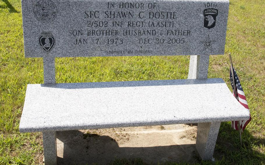 A granite bench at the Veterans Memorial Park in Lewiston, Maine, honors Sgt. 1st Class Shawn Dostie, who was killed in Iraq in December, 2005.