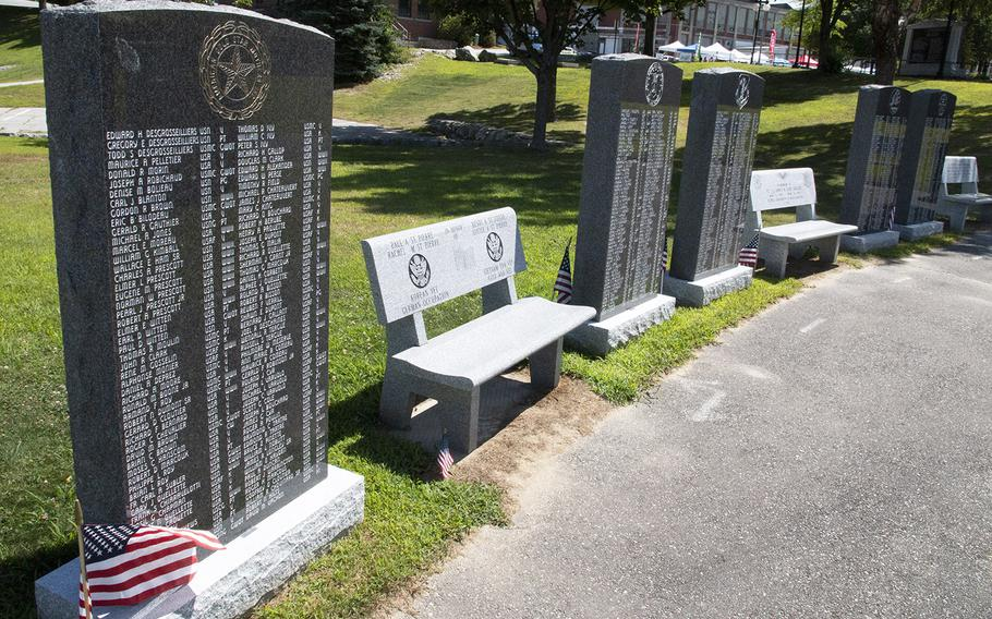 Memorial benches are placed between stones listing Lewiston-Auburn veterans at the Veterans Memorial Park in Lewiston, Maine, in August, 2019.