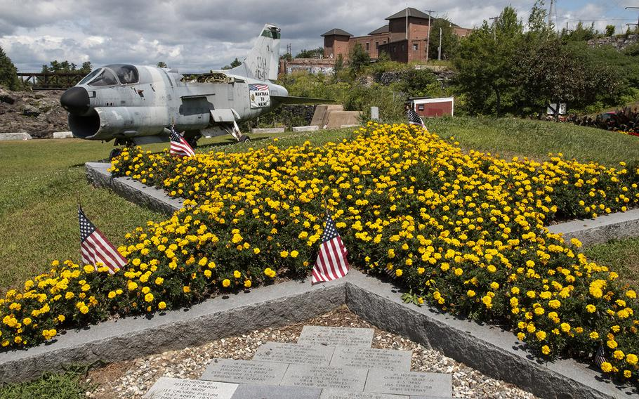 The Gold Star Mothers' floral monument at the Veterans Memorial Park in Lewiston, Maine, in August, 2019. In the background is an A-7D Corsair attack aircraft.