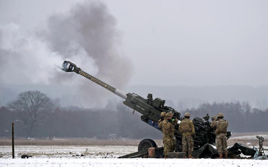 Soldiers with Bulldog Battery, 2nd Cavalry Regiment, fire a 155 mm round during a live-fire exercise in Vilseck, Germany, Dec. 12, 2019.