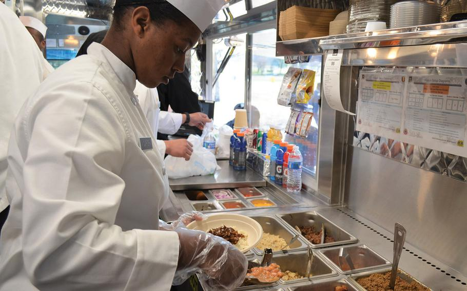 Pvt. Aniyaa Carter scoops pinto beans for a Tex-Mex burrito bowl Feb. 6, 2020, at Fort Hood, Texas. Though this is the Army's sixth food truck, Fort Hood's is the first to offer Tex-Mex menu items.