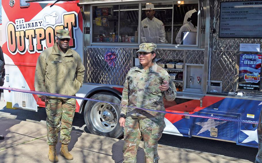 Sgt. Maj. Sylvia Thomas, III Corps chief culinary management sergeant major, welcomes customers to Fort Hood's Culinary Outpost food truck Feb. 6, 2020. The Army has six trucks at five bases to get meals to soldiers working in locations on base that are not close to a dining facility.