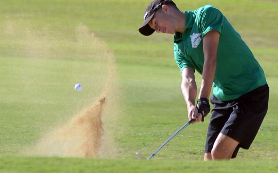 Kubasaki senior Bryce Tobin blasts out of a sand trap approaching the green on the 503-yard, par-5 10th hole.